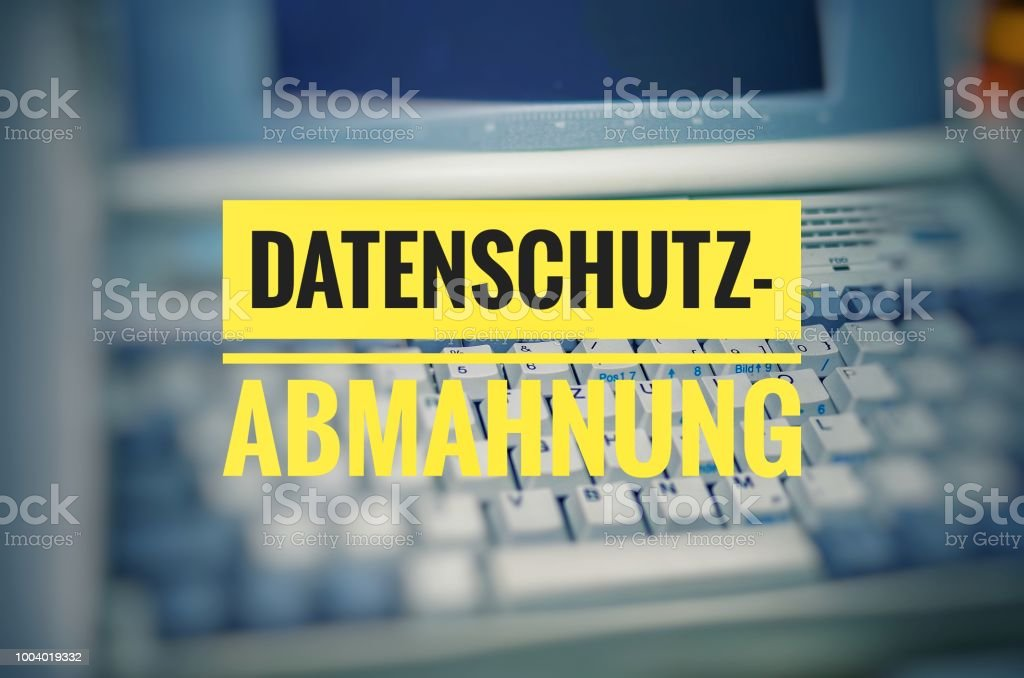 Laptop with in german Datenschutz-Abmahnung in english privacy warning stock photo