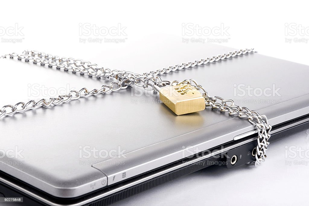 Laptop with lock and chain royalty-free stock photo