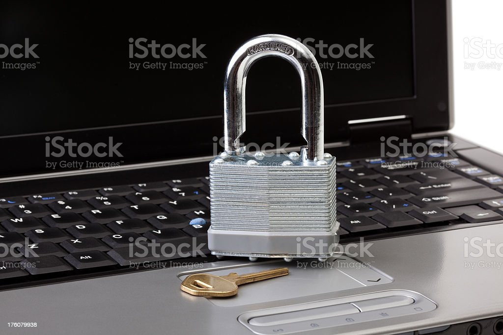 Laptop with lock and key royalty-free stock photo