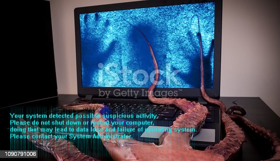Computer virus concept. Laptop with man inside seized by disgusting monster with long sticky tentacles. Data loss danger.