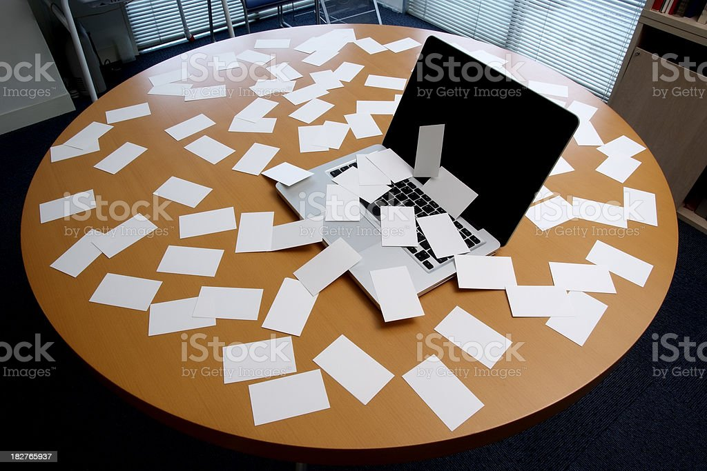Laptop with messy blank business card on office desk royalty-free stock photo