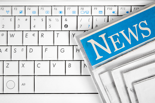 Laptop With Newspapers Stock Photo - Download Image Now