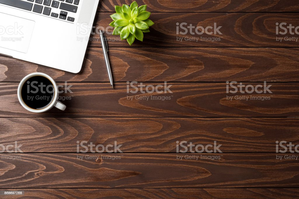 Laptop with office accessories on wooden table. Business background stock photo