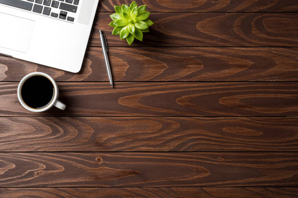 laptop with office accessories on wooden table. business background - above stock pictures, royalty-free photos & images