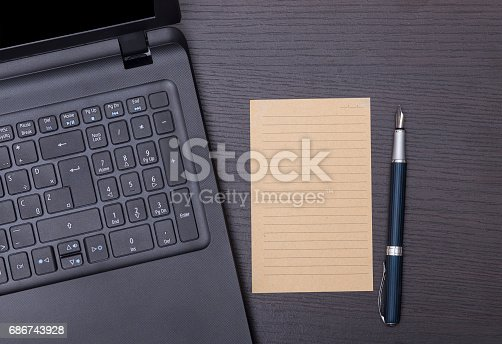 519189026 istock photo Laptop with pen and  blank paper . Office staff 686743928