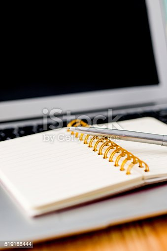 519189026 istock photo Laptop with pen and spiral notebook 519188444