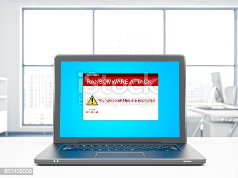 istock Laptop with ransomware attack on a desktop 822409006