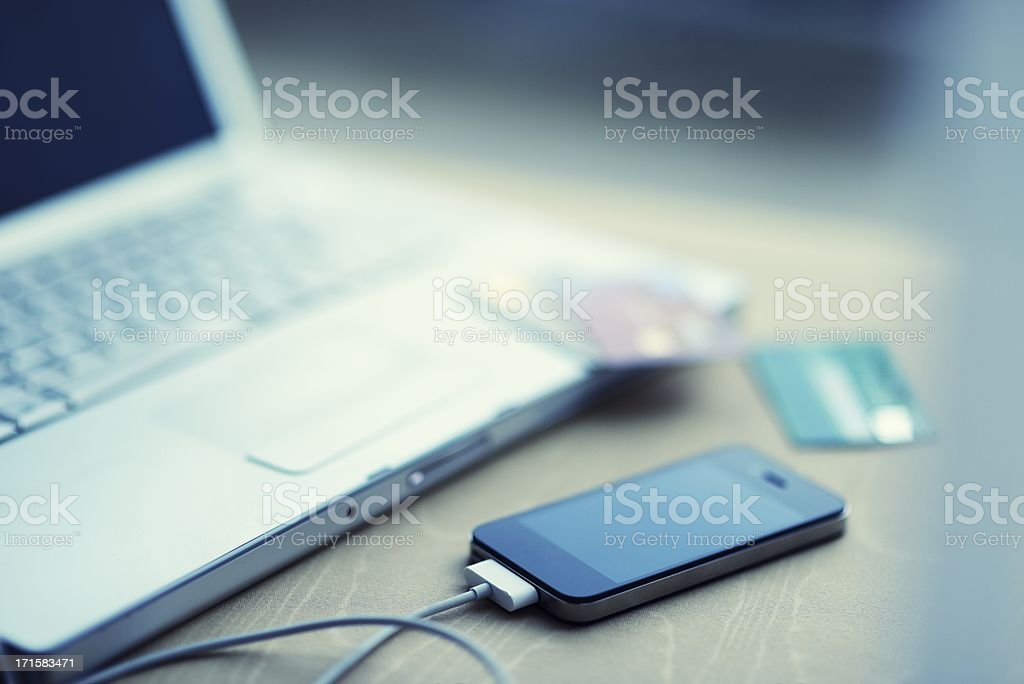 Laptop with Smart Phone and Credit Cards stock photo