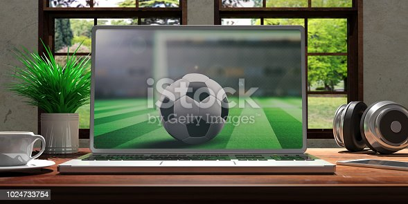 istock Laptop with soccer screen on wooden desk at home. Beautiful blurred nature background. 3d illustration 1024733754