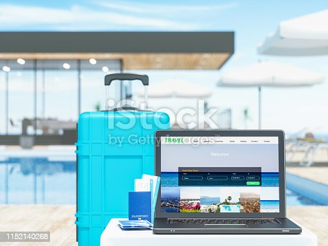 Laptop with suitcase near the luxury resort.  Concept of travel.