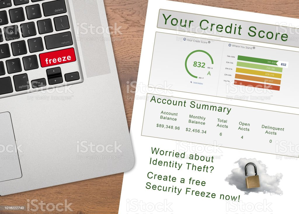 Laptop with the word Freeze on key with credit report stock photo