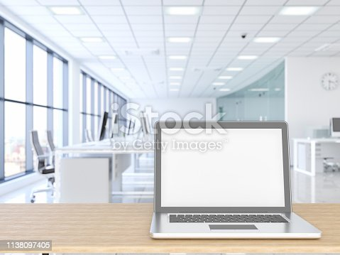 Laptop with wood empty surface and office building as background