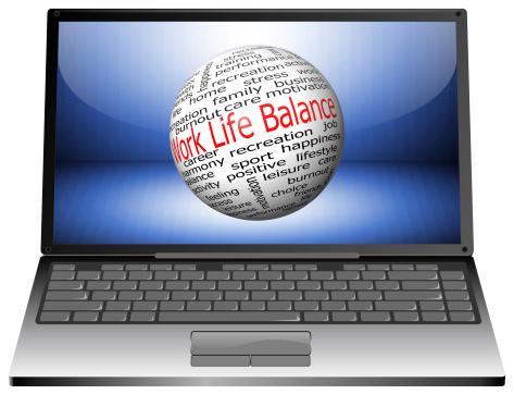 laptop with work life balance wordcloud on blue desktop