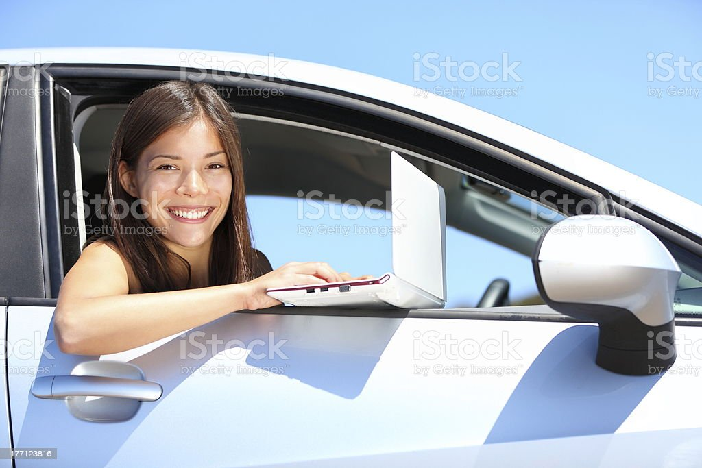 Laptop woman in car royalty-free stock photo