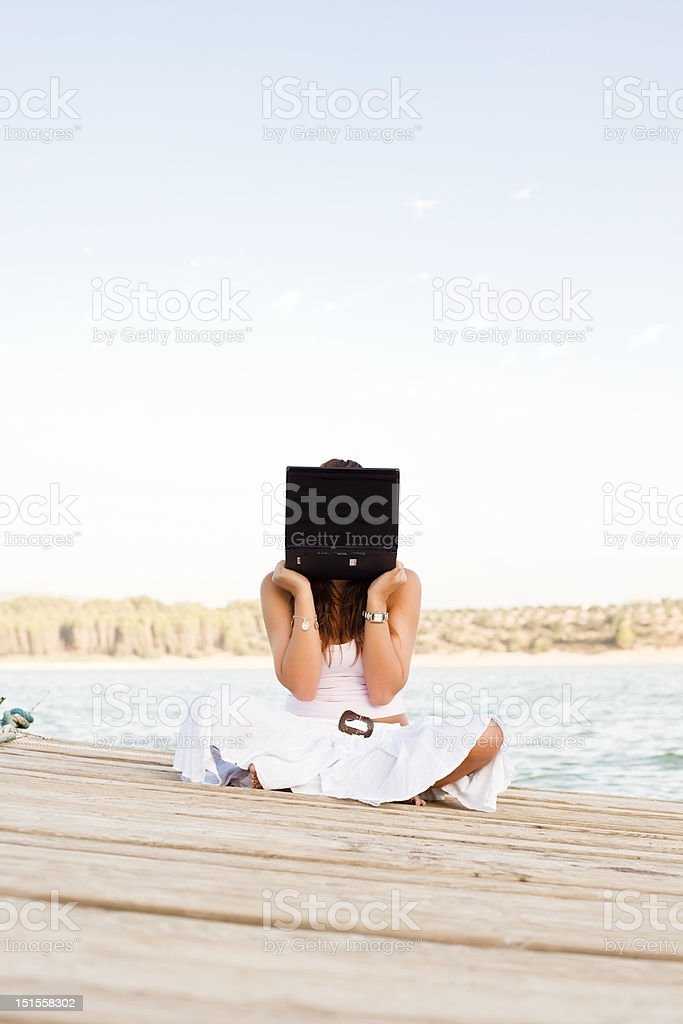 Laptop woman on pier royalty-free stock photo
