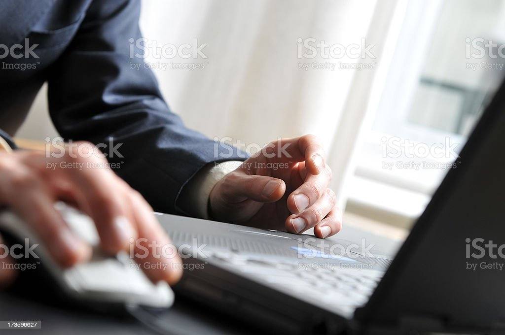 Laptop work, close-up on hands and computer royalty-free stock photo