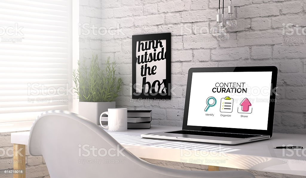 laptop workplace technology content curation stock photo