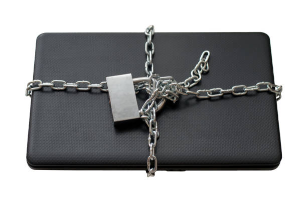 Laptop wrapped in a chain isolated on a white background, computer security stock photo