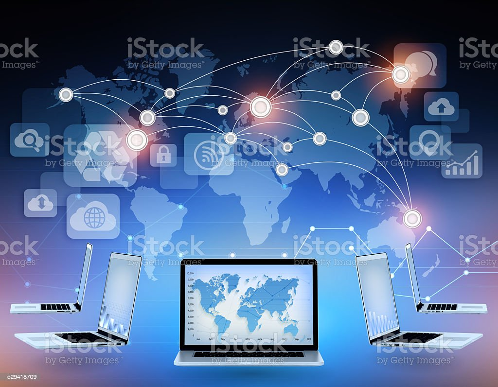 Laptops and world map with connection points in the network. stock photo