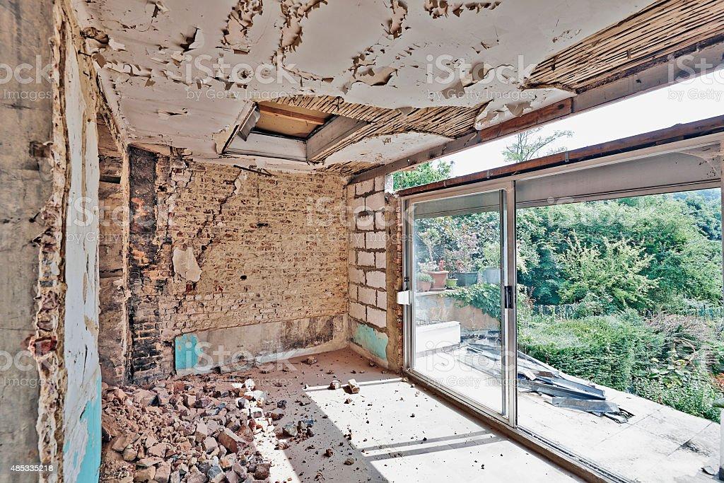 Large abandoned room under demolition before renovation