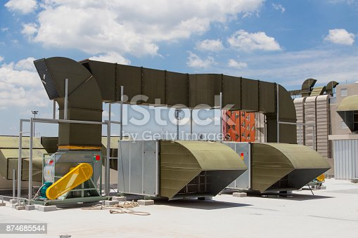 istock Large AC HVAC Air conditioner units on top of building 874685544