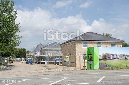 istock Large advertising hoarding for rural residential development being built 821851952