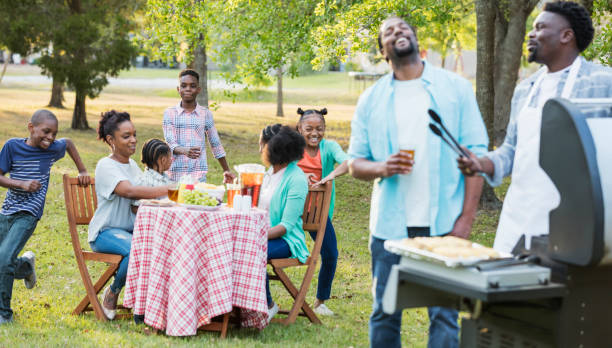 Large African-American family having backyard cookout stock photo
