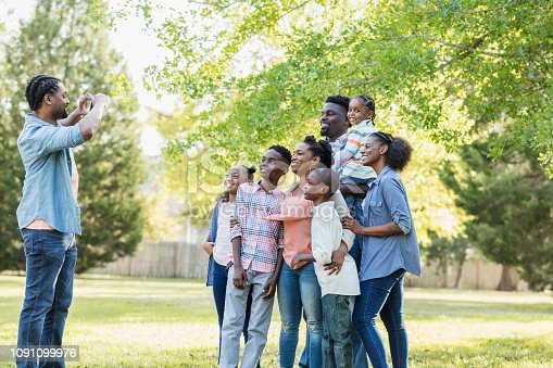 1091098220istockphoto Large African-American family, taking photo with phone 1091099976