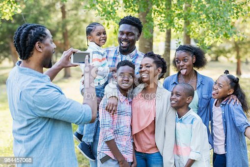1091098220istockphoto Large African-American family, taking photo with phone 984457068