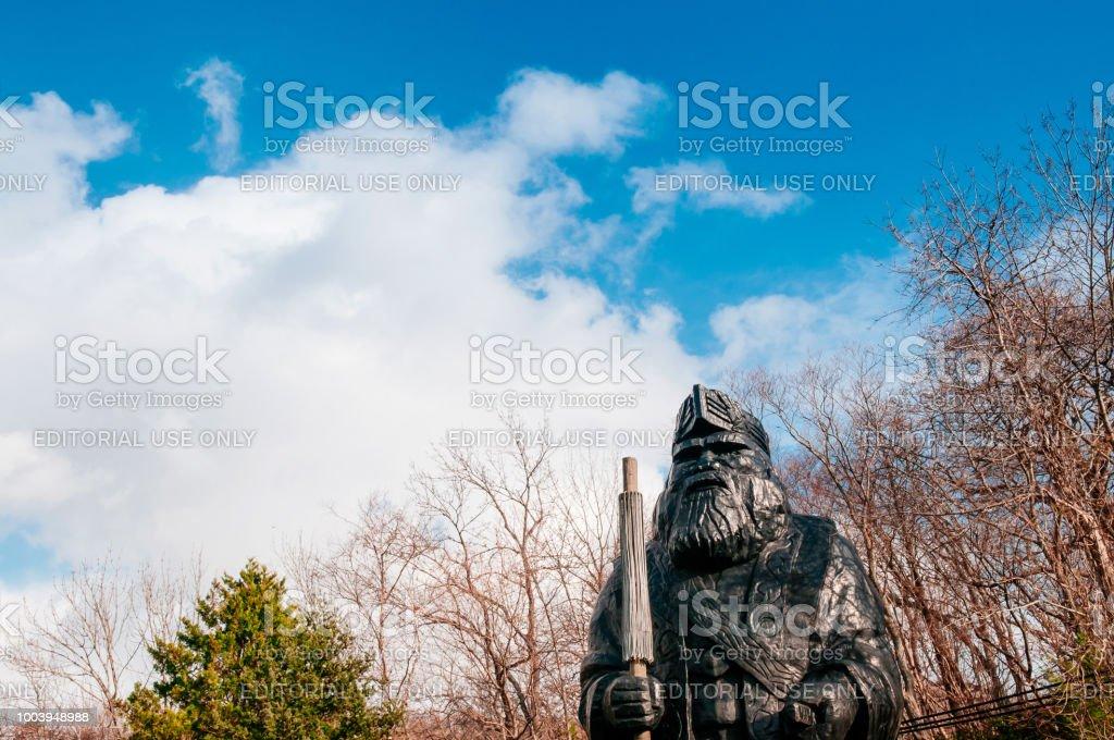 Large Ainu statue at Shiraoi Ainu Museum historic village in Hokkaido, Japan stock photo