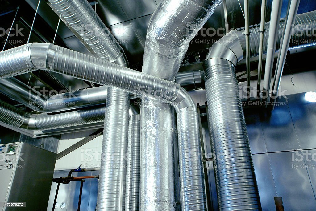 A large air conditioning system's ventilation pipes stock photo