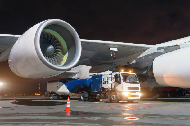 Large aircraft jet engines, Fueling a huge airplane, a truck with fuel with hoses connected to a fuel tank. Large aircraft jet engines, Fueling a huge airplane, a truck with fuel with hoses connected to a fuel tank biofuel stock pictures, royalty-free photos & images