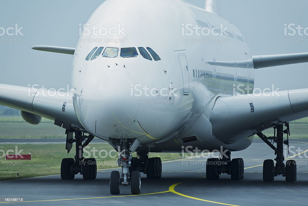 Large Airliner Taxiing on Runway, Front View royalty-free stock photo
