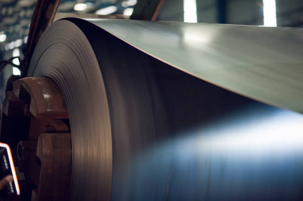 Large aluminium metal steel rolls in the factory Image of Large aluminium metal steel rolls in the factory. sheet metal stock pictures, royalty-free photos & images