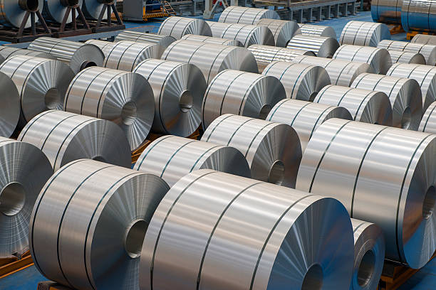 large aluminium steel rolls in the factory - aluminium stock photos and pictures