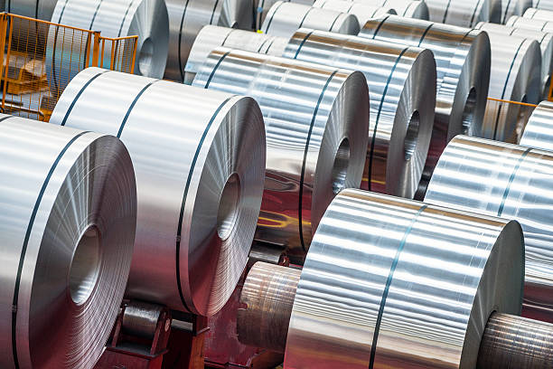 large aluminum steel rolls in the factory - aluminium stock photos and pictures