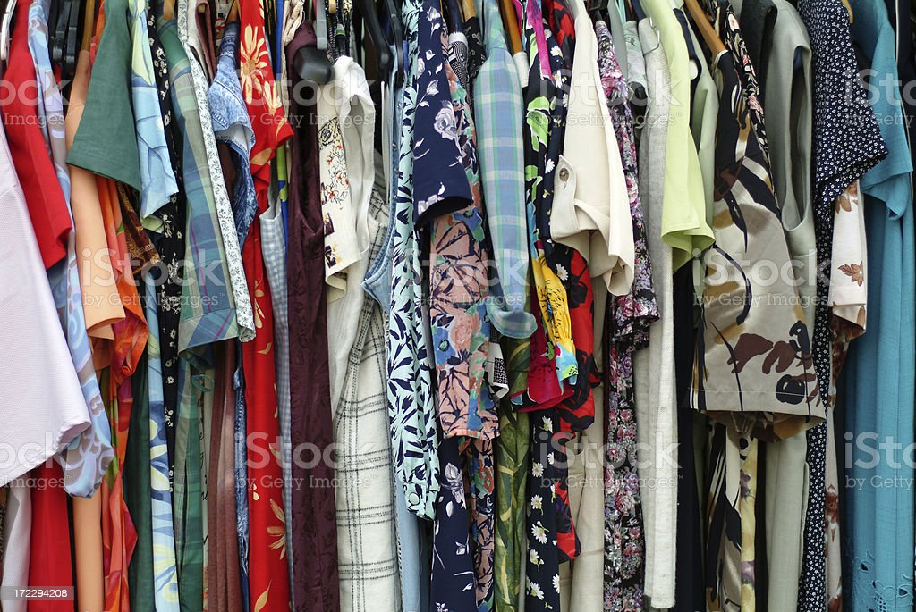 A large amount of colorful dresses hanging on a rack  royalty-free stock photo