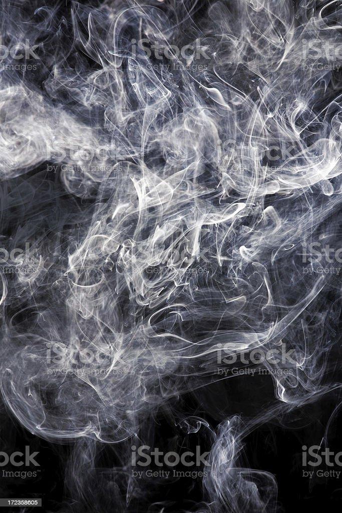Large amount of dense white smoke on a black background royalty-free stock photo