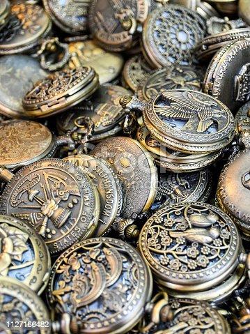 Large amount of similar pocket watches close together