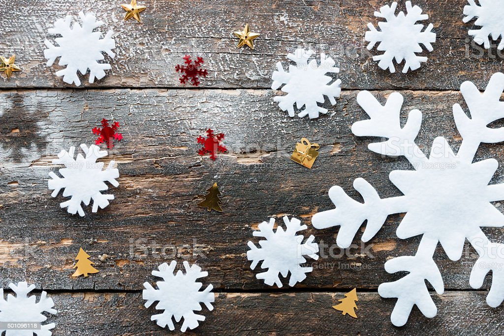 Large And Small Snowflakes On A Wooden Background Stock Photo