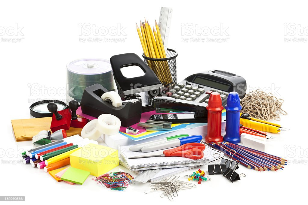 Large assortment of office supplies on white backdrop
