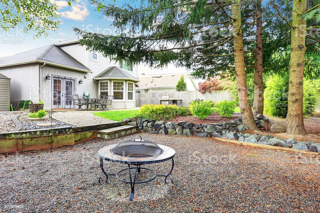 Large backyard with beautiful landscape and fire pit. stock photo
