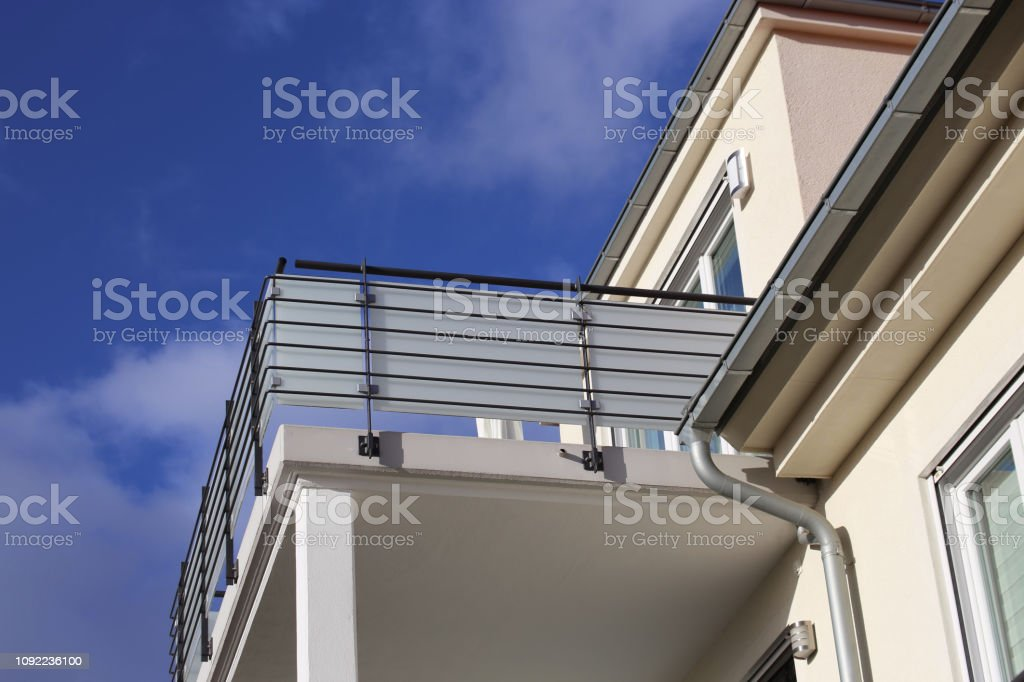 Large balcony with railing made of glass and stainless steel