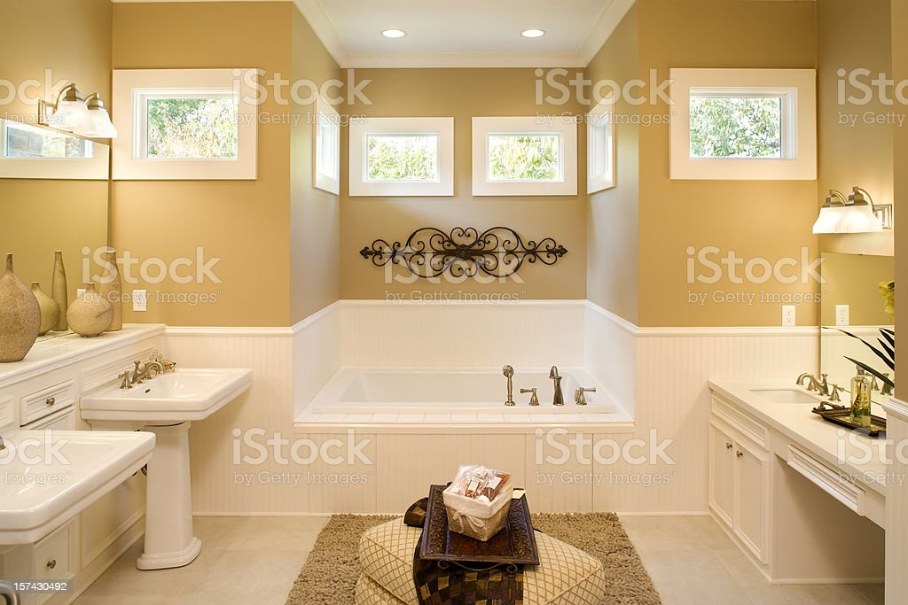 Large bathroom with pedestal sinks and large tub stock photo