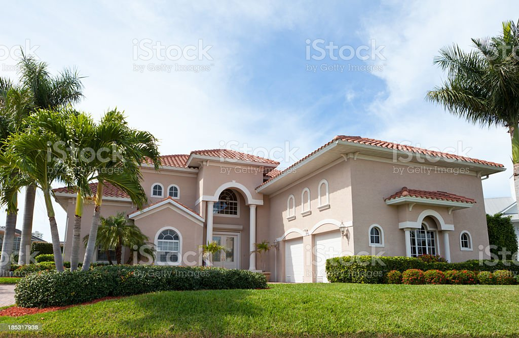 Large beautiful house with palm trees in Florida stock photo