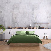 Interior with bed, modern nightstand and wall lamp, armchair, many books around, plant, blank wall. Copy space template