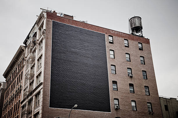 large billboard in the city - building exterior stock photos and pictures