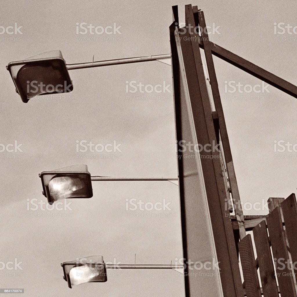 Large billboard lit by lamps royalty-free stock photo