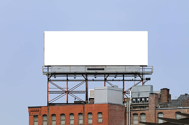 Large billboard on the top of a building in a city stock photo