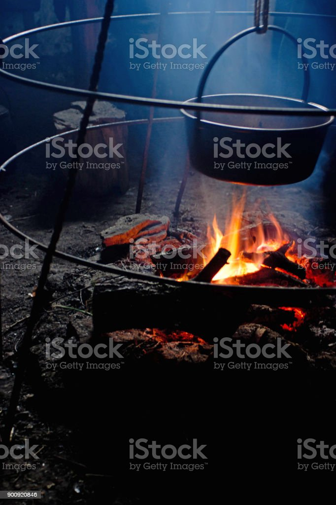 Large black pan on open fire stock photo